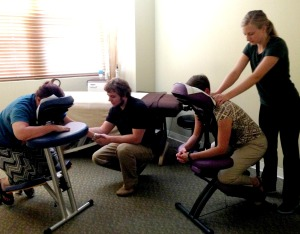 """Justin and Mallory wowed the """"Women who Wine"""" group with chair massages in 2014"""