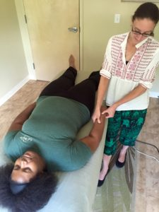 Jamee Williams, LMT, demonstrates Acupressure on her colleague.