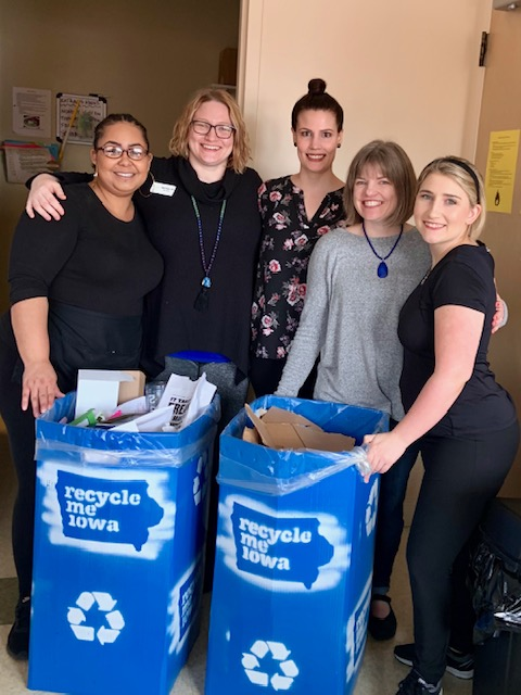 East Village Spa employees with recycle me Iowa storage containers